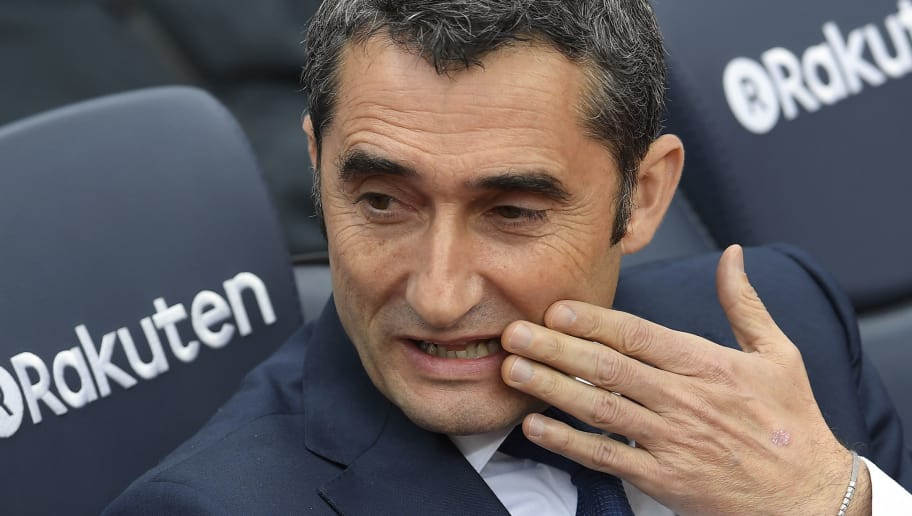 Barcelona's Spanish coach Ernesto Valverde sits on the bench before the Spanish league footbal match between FC Barcelona and Valencia CF at the Camp Nou stadium in Barcelona on April 14, 2018. / AFP PHOTO / LLUIS GENE        (Photo credit should read LLUIS GENE/AFP/Getty Images)