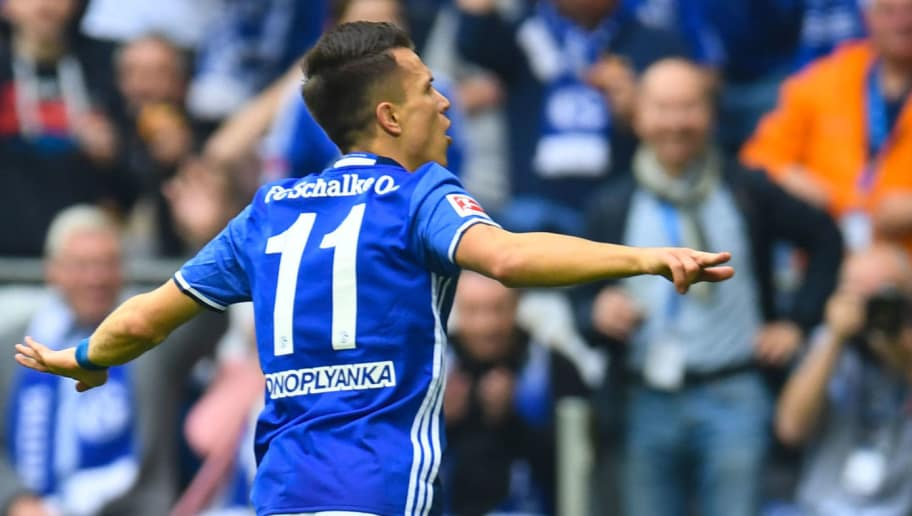 Schalke's Ukrainian midfielder Yevhen Konoplyanka celebrates after scoring during the German first division Bundesliga football match FC Schalke 04 vs Borussia Dortmund, in Gelsenkirchen, western Germany, on April 15, 2018. / AFP PHOTO / Patrik STOLLARZ / RESTRICTIONS: DURING MATCH TIME: DFL RULES TO LIMIT THE ONLINE USAGE TO 15 PICTURES PER MATCH AND FORBID IMAGE SEQUENCES TO SIMULATE VIDEO. == RESTRICTED TO EDITORIAL USE == FOR FURTHER QUERIES PLEASE CONTACT DFL DIRECTLY AT + 49 69 650050         (Photo credit should read PATRIK STOLLARZ/AFP/Getty Images)