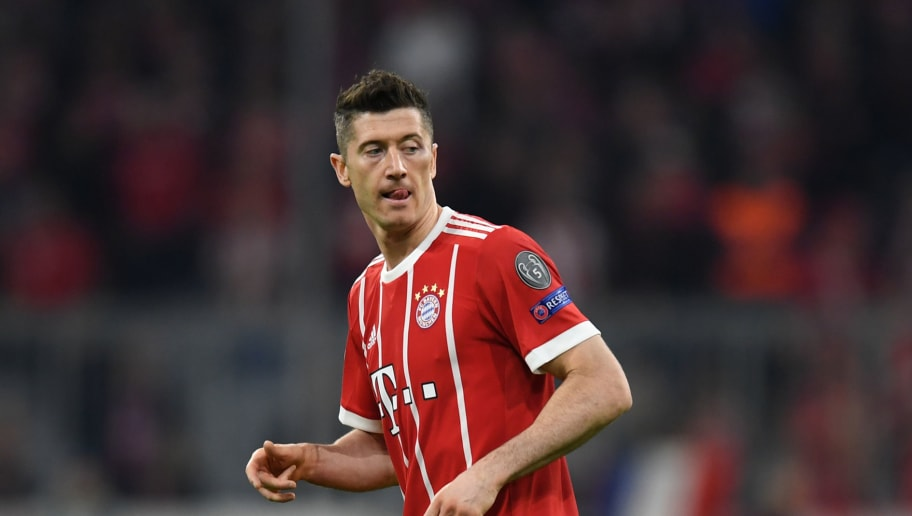 Bayern Munich's Polish forward Robert Lewandowski reacts during the UEFA Champions League quarter-final second leg football match between FC Bayern Munich and Sevilla FC on April 11, 2018 in Munich, southern Germany. Bayern Munich marched into another Champions League semi-final despite 10-man Sevilla holding them to a goalless draw at home. / AFP PHOTO / Christof STACHE        (Photo credit should read CHRISTOF STACHE/AFP/Getty Images)