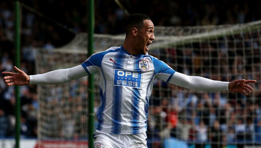 HUDDERSFIELD, ENGLAND - APRIL 14:  Tom Ince of Huddersfield Town celebrates after scoring his sides first goal during the Premier League match between Huddersfield Town and Watford at John Smith's Stadium on April 14, 2018 in Huddersfield, England.  (Photo by Jan Kruger/Getty Images)