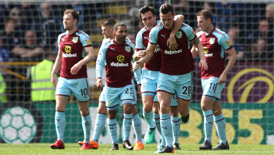 BURNLEY, ENGLAND - APRIL 14:  Kevin Long of Burnley celebrates with teammate Jack Cork after scoring his sides second goal during the Premier League match between Burnley and Leicester City at Turf Moor on April 14, 2018 in Burnley, England.  (Photo by Matthew Lewis/Getty Images)