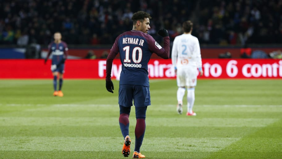 Paris Saint-Germain's Brazilian forward Neymar Jr celebrates after Marseille's Portuguese defender Rolando (unseen) scored an own goal after a kick of Neymar during the French L1 football match between Paris Saint-Germain (PSG) and Marseille (OM) at the Parc des Princes in Paris on February 25, 2018.  / AFP PHOTO / GEOFFROY VAN DER HASSELT        (Photo credit should read GEOFFROY VAN DER HASSELT/AFP/Getty Images)