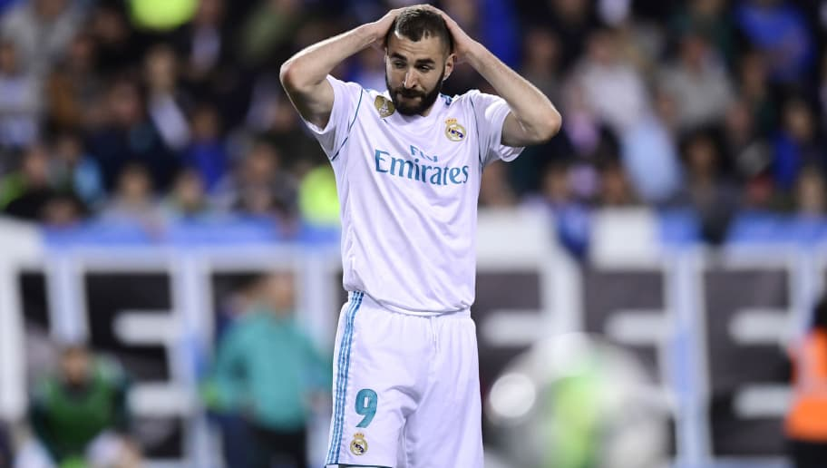 Real Madrid's French forward Karim Benzema gestures during the Spanish league footbal match between Malaga CF and Real Madrid CF at La Rosaleda stadium in Malaga on April 15, 2018. / AFP PHOTO / JAVIER SORIANO        (Photo credit should read JAVIER SORIANO/AFP/Getty Images)