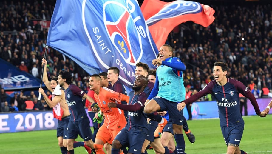 TOPSHOT - Paris Saint-Germain's Uruguayan forward Edinson Cavani celebrates after scoring a goal during the French L1 football match between Paris Saint-Germain (PSG) and Monaco (ASM) on April 15, 2018, at the Parc des Princes stadium in Paris. Paris Saint-Germain won the match and claim their seventh French League title.  / AFP PHOTO / CHRISTOPHE ARCHAMBAULT        (Photo credit should read CHRISTOPHE ARCHAMBAULT/AFP/Getty Images)