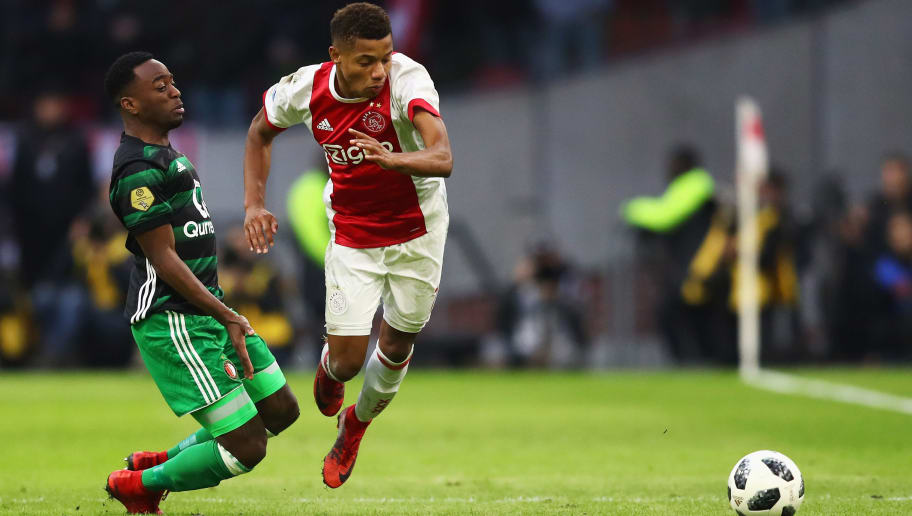 AMSTERDAM, NETHERLANDS - JANUARY 21:  Ridgeciano Haps of Feyenoord tackles David Neres of Ajax during the Dutch Eredivisie match between Ajax Amsterdam and Feyenoord at Amsterdam ArenA on January 21, 2018 in Amsterdam, Netherlands.  (Photo by Dean Mouhtaropoulos/Getty Images)