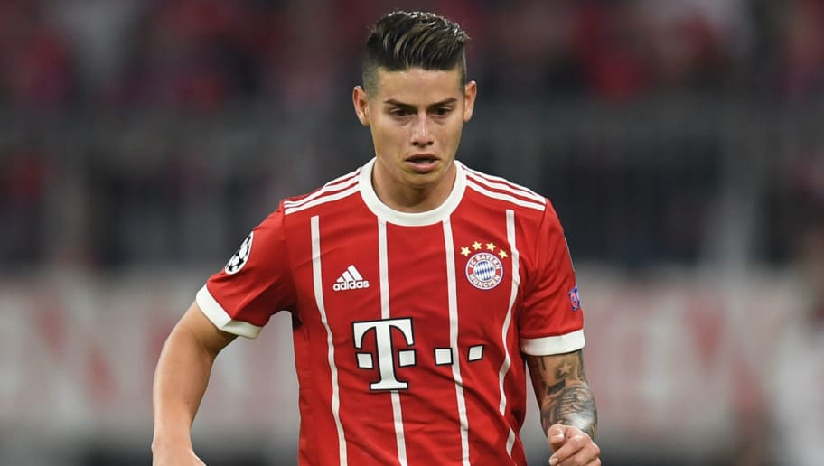 Bayern Munich's Colombian midfielder James Rodriguez plays the ball during the UEFA Champions League quarter-final second leg football match between FC Bayern Munich and Sevilla FC on April 11, 2018 in Munich, southern Germany. Bayern Munich marched into another Champions League semi-final despite 10-man Sevilla holding them to a goalless draw at home. / AFP PHOTO / Christof STACHE        (Photo credit should read CHRISTOF STACHE/AFP/Getty Images)