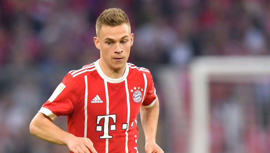 MUNICH, GERMANY - APRIL 14: Joshua Kimmich of Bayern Muenchen plays the ball during the Bundesliga match between FC Bayern Muenchen and Borussia Moenchengladbach at Allianz Arena on April 14, 2018 in Munich, Germany. (Photo by Sebastian Widmann/Bongarts/Getty Images,)