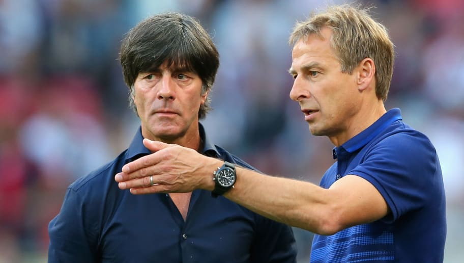 COLOGNE, GERMANY - JUNE 10:  Joachim Loew (L), head coach of Germany talks to Juergen Klisnmann, head coach of USA prior to the international friendly match between Germany and USA at RheinEnergieStadion on June 10, 2015 in Cologne, Germany.  (Photo by Alexander Hassenstein/Bongarts/Getty Images)