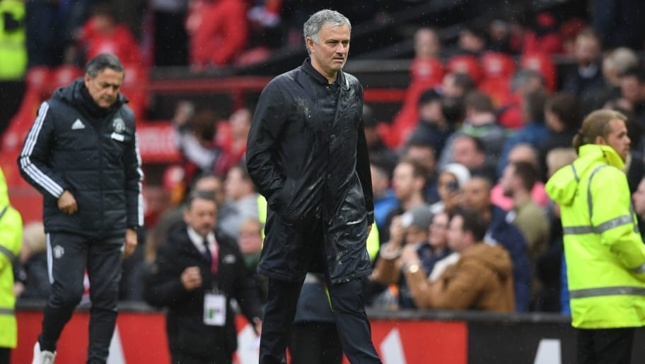 Manchester United's Portuguese manager Jose Mourinho walks off after the English Premier League football match between Manchester United and West Bomwich Albion at Old Trafford in Manchester, north west England, on April 15, 2018. Manchester City were crowned Premier League champions on Sunday as Manchester United crashed to a shock 1-0 defeat against West Bromwich Albion. / AFP PHOTO / Paul ELLIS / RESTRICTED TO EDITORIAL USE. No use with unauthorized audio, video, data, fixture lists, club/league logos or 'live' services. Online in-match use limited to 75 images, no video emulation. No use in betting, games or single club/league/player publications.  /         (Photo credit should read PAUL ELLIS/AFP/Getty Images)