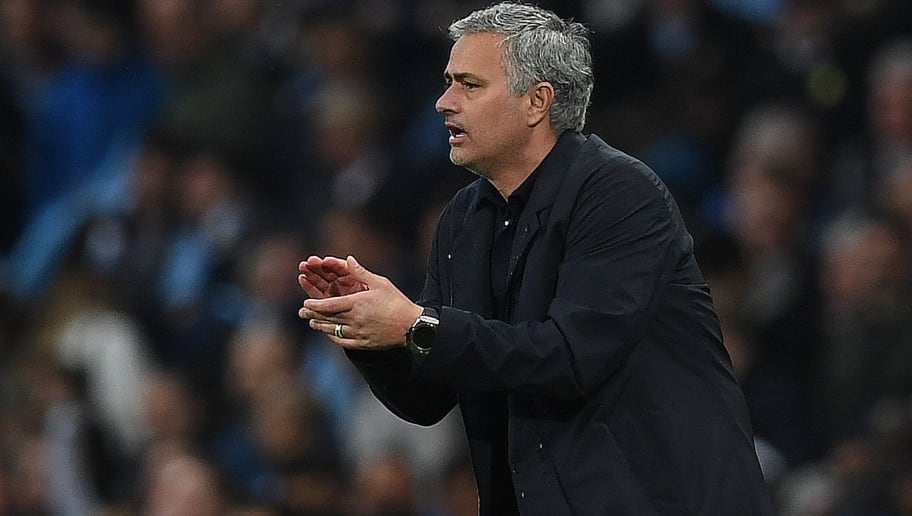 Manchester United's Portuguese manager Jose Mourinho a[pplauds during the English Premier League football match between Manchester City and Manchester United at the Etihad Stadium in Manchester, north west England, on April 7, 2018. Manchester United won the match 3-2. / AFP PHOTO / Paul ELLIS / RESTRICTED TO EDITORIAL USE. No use with unauthorized audio, video, data, fixture lists, club/league logos or 'live' services. Online in-match use limited to 75 images, no video emulation. No use in betting, games or single club/league/player publications.  /         (Photo credit should read PAUL ELLIS/AFP/Getty Images)
