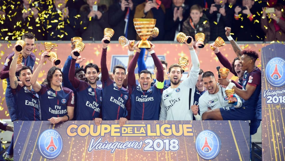 TOPSHOT - Paris Saint-Germain's Brazilian defender Thiago Silva (C) holds the trophy as he celebrates with teammates German goalkeeper Kevin Trapp (2R), French goalkeeper Alphonse Areola (R), French defender Presnel Kimpembe (R) Argentinian forward Angel Di Maria (3L), Argentinian midfielder Javier Pastore (2L), Uruguayan forward Edinson Cavani (2L),Paris Saint-Germain's Spanish defender Yuri Berchiche (L) and Argentinian midfielder Giovanni Lo Celso after victory in the French League Cup final football match between Monaco (ASM) and Paris Saint-Germain (PSG) at The Matmut Atlantique Stadium in Bordeaux, southwestern France on March 31, 2018.  / AFP PHOTO / NICOLAS TUCAT        (Photo credit should read NICOLAS TUCAT/AFP/Getty Images)