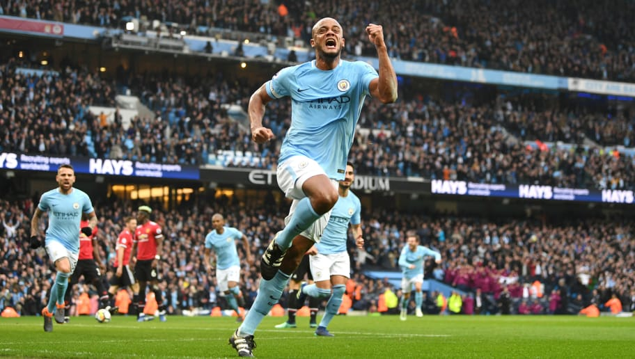 MANCHESTER, ENGLAND - APRIL 07:  Vincent Kompany of Manchester City celebrates scoring his side's first goal during the Premier League match between Manchester City and Manchester United at Etihad Stadium on April 7, 2018 in Manchester, England.  (Photo by Michael Regan/Getty Images)