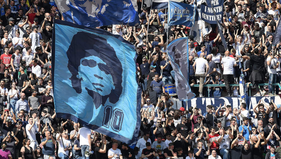 NAPLES, ITALY - APRIL 08: SSC Napoli supporters cheer their team during the serie A match between SSC Napoli and AC Chievo Verona at Stadio San Paolo on April 8, 2018 in Naples, Italy.  (Photo by Francesco Pecoraro/Getty Images)