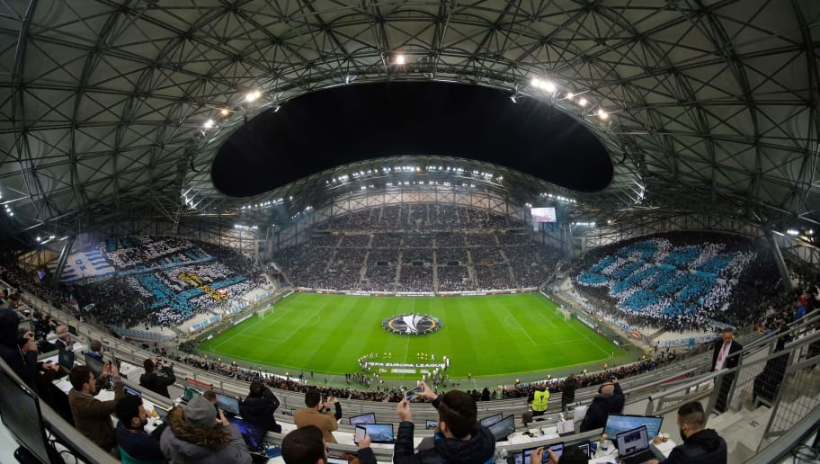 Spectators watch the ceremony ahead of the Europa League quarter final second leg football match between Olympique de Marseille (OM) and RB Leipzig at the Velodrome stadium in Marseille on April 12, 2018. / AFP PHOTO / Emmanuel BARRANGUET        (Photo credit should read EMMANUEL BARRANGUET/AFP/Getty Images)