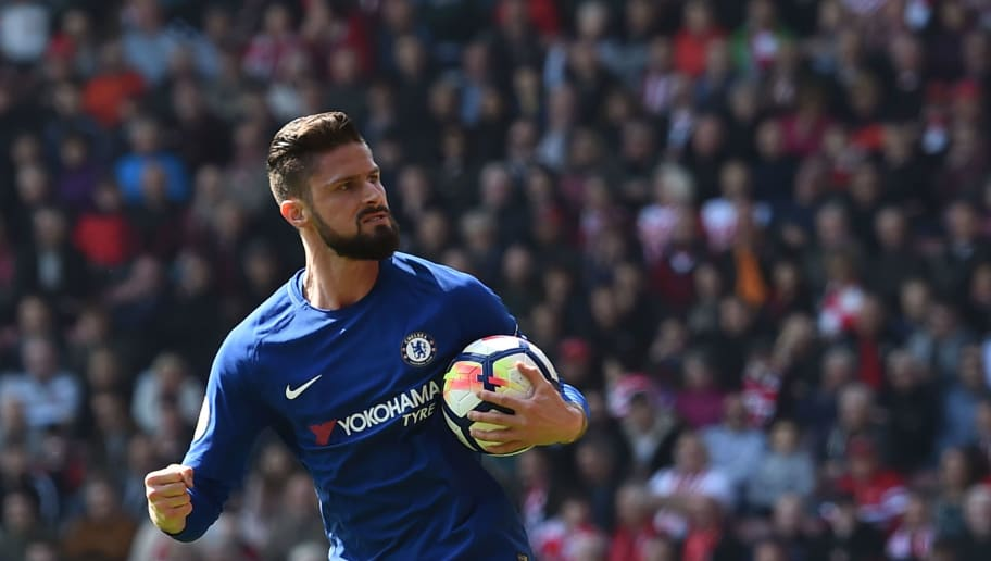 Chelsea's French attacker Olivier Giroud celebrates scoring their first goal during the English Premier League football match between Southampton and Chelsea at St Mary's Stadium in Southampton, southern England on April 14, 2018. / AFP PHOTO / Glyn KIRK / RESTRICTED TO EDITORIAL USE. No use with unauthorized audio, video, data, fixture lists, club/league logos or 'live' services. Online in-match use limited to 75 images, no video emulation. No use in betting, games or single club/league/player publications.  /         (Photo credit should read GLYN KIRK/AFP/Getty Images)