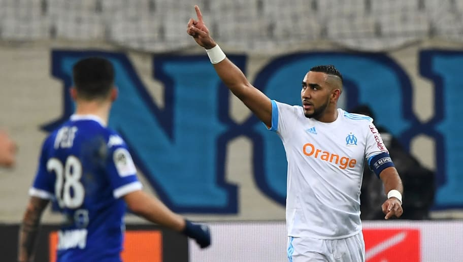 Olympique de Marseille's French forward Dimitri Payet (C) celebrates after scoring a goal during the French L1 football match between Olympique de Marseille (OM) and Troyes on December 20, 2017 at the Velodrome stadium in Marseille, southern France. / AFP PHOTO / ANNE-CHRISTINE POUJOULAT        (Photo credit should read ANNE-CHRISTINE POUJOULAT/AFP/Getty Images)
