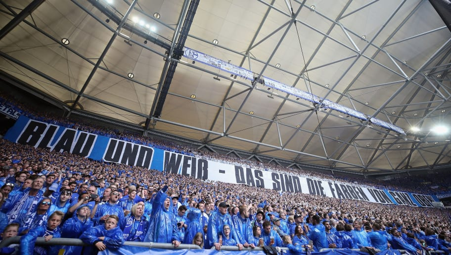 GELSENKIRCHEN, GERMANY - APRIL 15: Fans of Schalke cheer during the Bundesliga match between FC Schalke 04 and Borussia Dortmund at Veltins-Arena on April 15, 2018 in Gelsenkirchen, Germany.  (Photo by Alex Grimm/Bongarts/Getty Images)