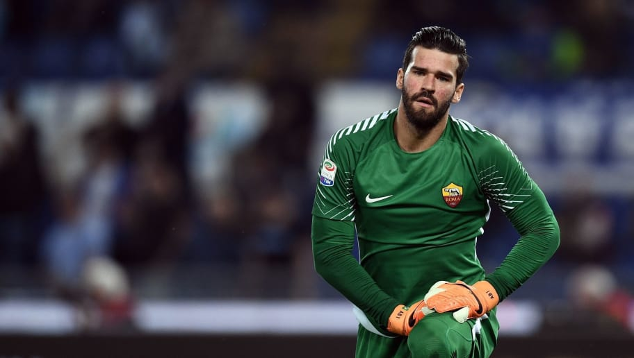Roma's goalkeeper from Brazil Alisson Ramses Becker looks on during the Italian Serie A football match Lazio vs Roma at the Olympic Stadium in Rome on April 15, 2018. / AFP PHOTO / FILIPPO MONTEFORTE        (Photo credit should read FILIPPO MONTEFORTE/AFP/Getty Images)