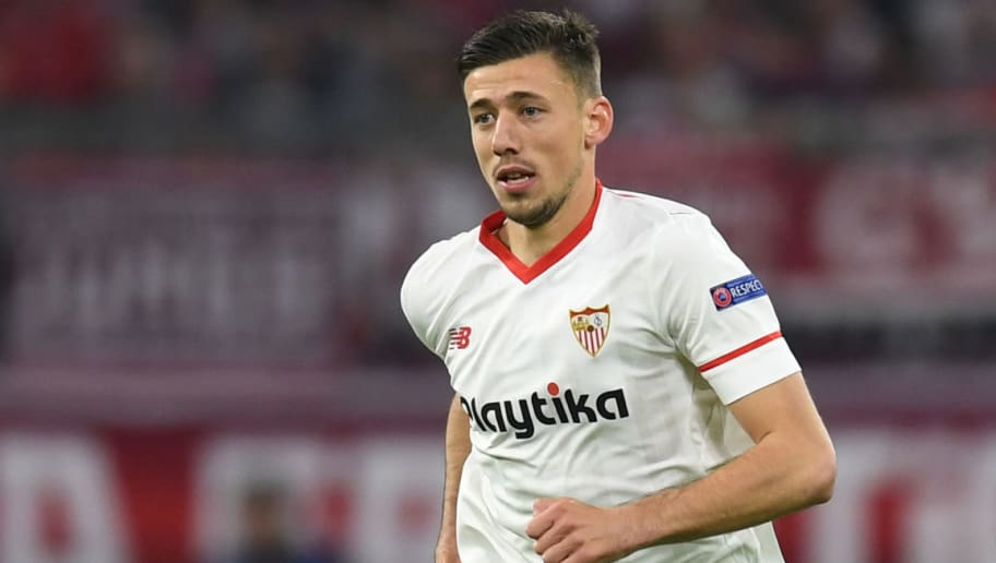 Sevilla's French defender Clement Lenglet plays the ball during the UEFA Champions League quarter-final second leg football match between FC Bayern Munich and Sevilla FC on April 11, 2018 in Munich, southern Germany. Bayern Munich marched into another Champions League semi-final despite 10-man Sevilla holding them to a goalless draw at home. / AFP PHOTO / Christof STACHE        (Photo credit should read CHRISTOF STACHE/AFP/Getty Images)