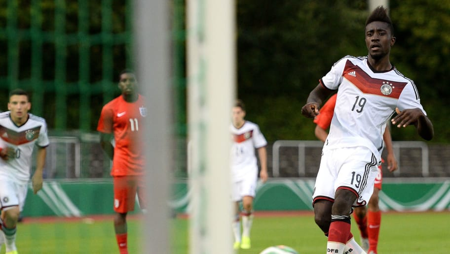 BERGISCH GLADBACH, GERMANY - SEPTEMBER 04:  Prince-Osei Owusu (R) of Germany scores his team's first goal by a penalty during the U19 international friendly match between Germany and England  on September 4, 2015 in Bergisch Gladbach, Germany.  (Photo by Sascha Steinbach/Bongarts/Getty Images)
