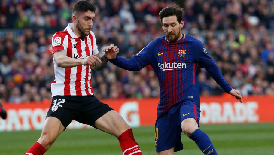 Athletic Bilbao's Spanish defender Unai Nunez (L) vies with Barcelona's Argentinian forward Lionel Messi (R) during the Spanish League football match between FC Barcelona and Athletic Club Bilbao at the Camp Nou stadium in Barcelona on March 18, 2018. / AFP PHOTO / Pau Barrena        (Photo credit should read PAU BARRENA/AFP/Getty Images)
