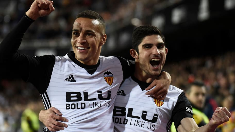 Valencia's Brazilian forward Rodrigo Moreno (L) celebrates with Valencia's Portuguese midfielder Manuel Guedes after scoring a goal during the Spanish league football match between Valencia CF and RCD Espanyol at the Mestalla stadium in Valencia on April 8, 2018. / AFP PHOTO / JOSE JORDAN        (Photo credit should read JOSE JORDAN/AFP/Getty Images)