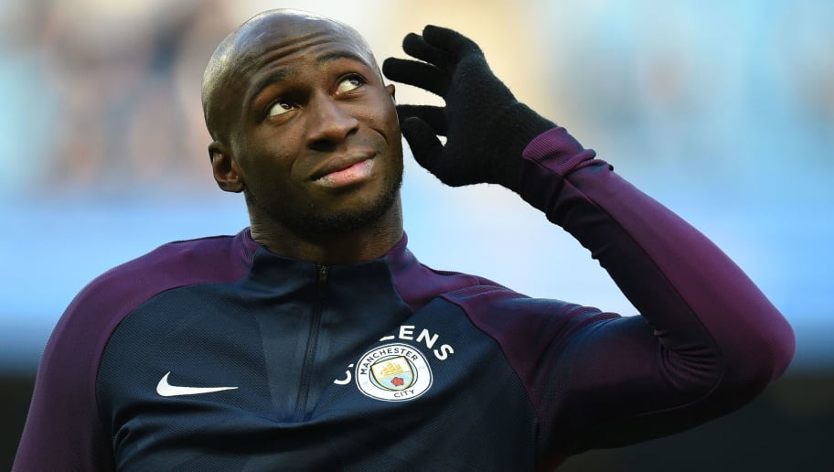 Manchester City's French defender Eliaquim Mangala warms up for the English FA Cup third round football match between Manchester City and Burnley at Etihad Stadium in Manchester, north west England on January 6, 2018. / AFP PHOTO / Oli SCARFF / RESTRICTED TO EDITORIAL USE. No use with unauthorized audio, video, data, fixture lists, club/league logos or 'live' services. Online in-match use limited to 75 images, no video emulation. No use in betting, games or single club/league/player publications.  /         (Photo credit should read OLI SCARFF/AFP/Getty Images)