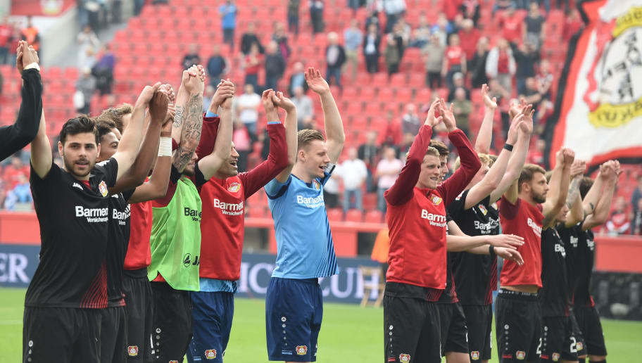 Leverkusen's players react after the German first division Bundesliga football match Bayer 04 Leverkusen vs Eintracht Frankfurt, in Leverkusen, western Germany, on April 14, 2018. / AFP PHOTO / Patrik STOLLARZ / RESTRICTIONS: DURING MATCH TIME: DFL RULES TO LIMIT THE ONLINE USAGE TO 15 PICTURES PER MATCH AND FORBID IMAGE SEQUENCES TO SIMULATE VIDEO. == RESTRICTED TO EDITORIAL USE == FOR FURTHER QUERIES PLEASE CONTACT DFL DIRECTLY AT + 49 69 650050         (Photo credit should read PATRIK STOLLARZ/AFP/Getty Images)