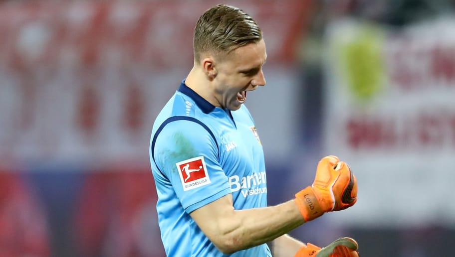 LEIPZIG, GERMANY - APRIL 09:  Bernd Leno, goalkeeper of Leverkusen celebrates the 4th goal during the Bundesliga match between RB Leipzig and Bayer 04 Leverkusen at Red Bull Arena on April 9, 2018 in Leipzig, Germany.  (Photo by Martin Rose/Bongarts/Getty Images)
