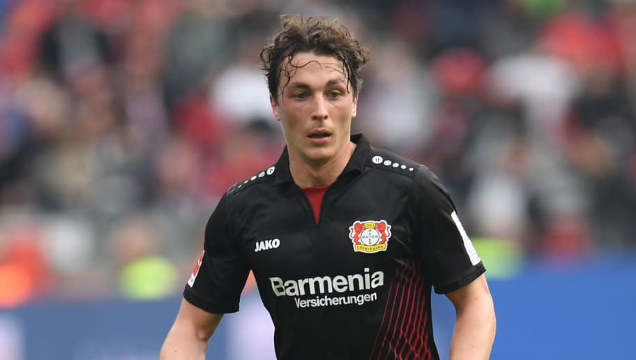 Leverkusen's Austrian midflielder Julian Baumgartlinger controls the ball during the German first division Bundesliga football match Bayer 04 Leverkusen vs Eintracht Frankfurt, in Leverkusen, western Germany, on April 14, 2018. / AFP PHOTO / Patrik STOLLARZ / RESTRICTIONS: DURING MATCH TIME: DFL RULES TO LIMIT THE ONLINE USAGE TO 15 PICTURES PER MATCH AND FORBID IMAGE SEQUENCES TO SIMULATE VIDEO. == RESTRICTED TO EDITORIAL USE == FOR FURTHER QUERIES PLEASE CONTACT DFL DIRECTLY AT + 49 69 650050         (Photo credit should read PATRIK STOLLARZ/AFP/Getty Images)