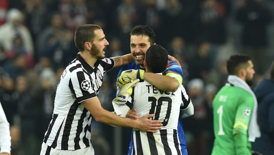 TURIN, ITALY - DECEMBER 09:  Leonardo Bonucci, Gianluigi Buffon and Carlos Tevez of Juventus celebrate at the end of the UEFA Champions League group A match between Juventus and Club Atletico de Madrid at Juventus Arena on December 9, 2014 in Turin, Italy.  (Photo by Valerio Pennicino/Getty Images)
