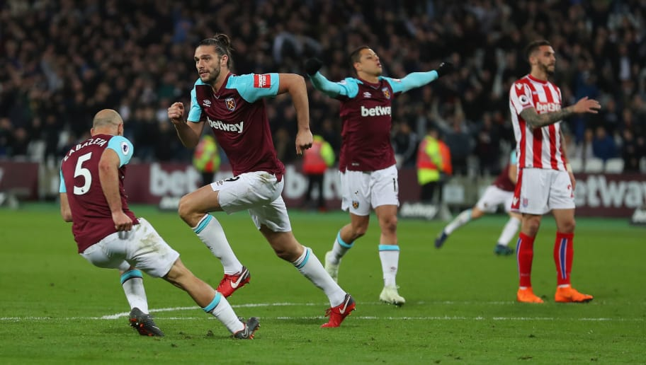 LONDON, ENGLAND - APRIL 16:  Andy Carroll of West Ham United celebrates with teammates Javier Hernandez of West Ham United and Pablo Zabaleta of West Ham United after scoring his sides first goal during the Premier League match between West Ham United and Stoke City at London Stadium on April 16, 2018 in London, England.  (Photo by Catherine Ivill/Getty Images)
