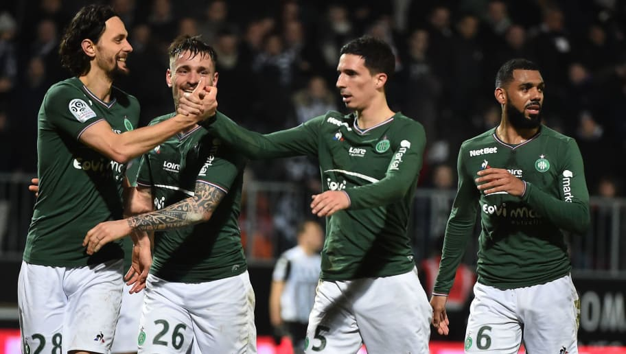 (From L) Saint-Etienne's Bosnia and Herzegovina defender Neven Subotic, Saint-Etienne's French defender Mathieu Debuchy, Saint-Etienne's French midfielder Vincent Pajot and Saint-Etienne's French midfielder Yann M'vila react after the French L1 Football match between Angers (SCO) and Saint-Etienne (ASSE), on February 17, 2018, at the Raymond Kopa Stadium, in Angers, northwestern France.  / AFP PHOTO / JEAN-FRANCOIS MONIER        (Photo credit should read JEAN-FRANCOIS MONIER/AFP/Getty Images)