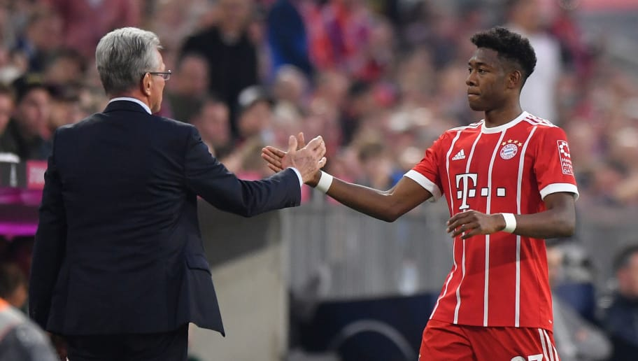 MUNICH, GERMANY - APRIL 14: Head coach Jupp Heynckes of Bayern Muenchen shakes hands with David Alaba during the Bundesliga match between FC Bayern Muenchen and Borussia Moenchengladbach at Allianz Arena on April 14, 2018 in Munich, Germany. (Photo by Sebastian Widmann/Bongarts/Getty Images,)