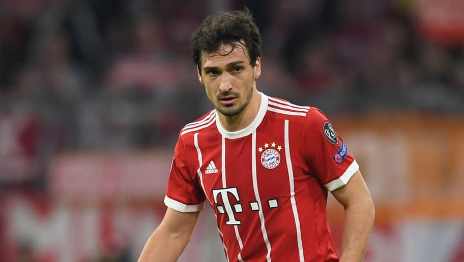 Bayern Munich's German defender Mats Hummels plays the ball during the UEFA Champions League quarter-final second leg football match between FC Bayern Munich and Sevilla FC on April 11, 2018 in Munich, southern Germany. Bayern Munich marched into another Champions League semi-final despite 10-man Sevilla holding them to a goalless draw at home. / AFP PHOTO / Christof STACHE        (Photo credit should read CHRISTOF STACHE/AFP/Getty Images)
