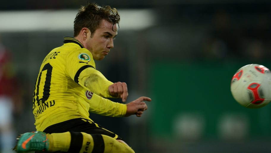 Dortmund's midfielder Mario Goetze scores during the German Cup football match Borussia Dortmund vs Hanover 96 in Dortmund, western Germany, on December 19, 2012. Dortmund won the match 5-1.  AFP PHOTO / PATRIK STOLLARZ  RESTRICTIONS / EMBARGO - DFB RULES PROHIBIT THE USE IN MMS SERVICES VIA HANDHELD DEVICES UNTIL TWO HOURS AFTER A MATCH. IMAGE SEQUENCES TO SIMULATE VIDEO IS NOT ALLOWED AT ANY TIME. FOR FURTHER QUERIES PLEASE CONTACT THE DFB DIRECTLY AT +49 69 67880.        (Photo credit should read PATRIK STOLLARZ/AFP/Getty Images)