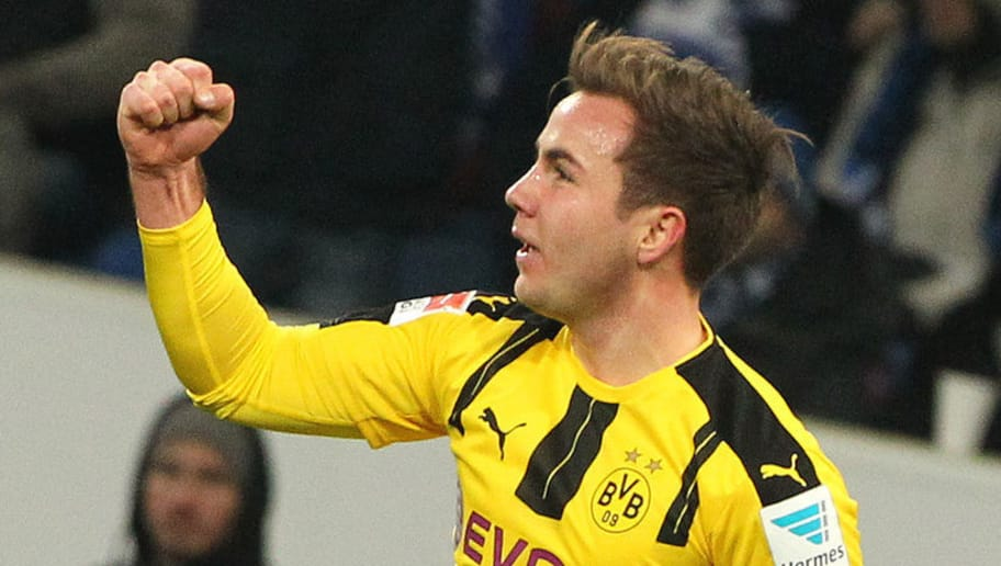 Dortmund's midfielder Mario Goetze celebrates scoring the 1-1 during the German first division Bundesliga football match between TSG Hoffenheim and BVB Borussia Dortmund at the Wirsol Rhein-Neckar-Arena in Sinsheim, southern Germany, on December 16, 2016. / AFP / Daniel ROLAND / RESTRICTIONS: DURING MATCH TIME: DFL RULES TO LIMIT THE ONLINE USAGE TO 15 PICTURES PER MATCH AND FORBID IMAGE SEQUENCES TO SIMULATE VIDEO. == RESTRICTED TO EDITORIAL USE == FOR FURTHER QUERIES PLEASE CONTACT DFL DIRECTLY AT + 49 69 650050         (Photo credit should read DANIEL ROLAND/AFP/Getty Images)