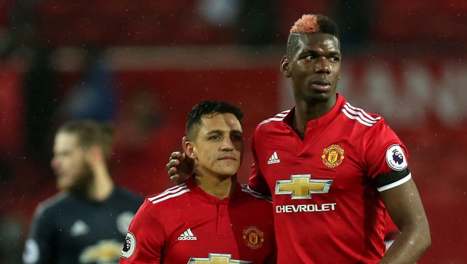 MANCHESTER, ENGLAND - FEBRUARY 03:  Alexis Sanchez and Paul Pogba of Manchester United leave the pitch following the Premier League match between Manchester United and Huddersfield Town at Old Trafford on February 3, 2018 in Manchester, England.  (Photo by Alex Morton/Getty Images)