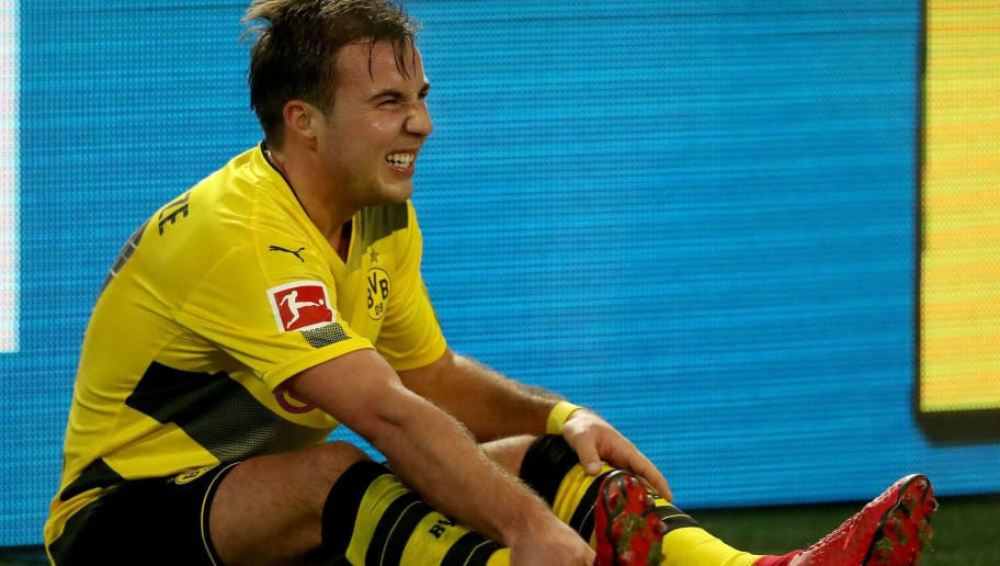 DORTMUND, GERMANY - NOVEMBER 25: Mario Goetze of Dortmund sits injured on the pitch during the Bundesliga match between Borussia Dortmund and FC Schalke 04 at Signal Iduna Park on November 25, 2017 in Dortmund, Germany.  (Photo by Christof Koepsel/Bongarts/Getty Images)