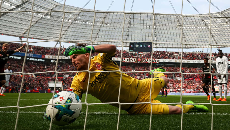 LEVERKUSEN, GERMANY - APRIL 14: Julian Brandt #10 of Bayer Leverkusen scores his teams first goal past goalkeeper Lukas Hradecky #1 of Eintracht Frankfurt during the Bundesliga match between Bayer 04 Leverkusen and Eintracht Frankfurt at BayArena on April 14, 2018 in Leverkusen, Germany. (Photo by Maja Hitij/Bongarts/Getty Images)