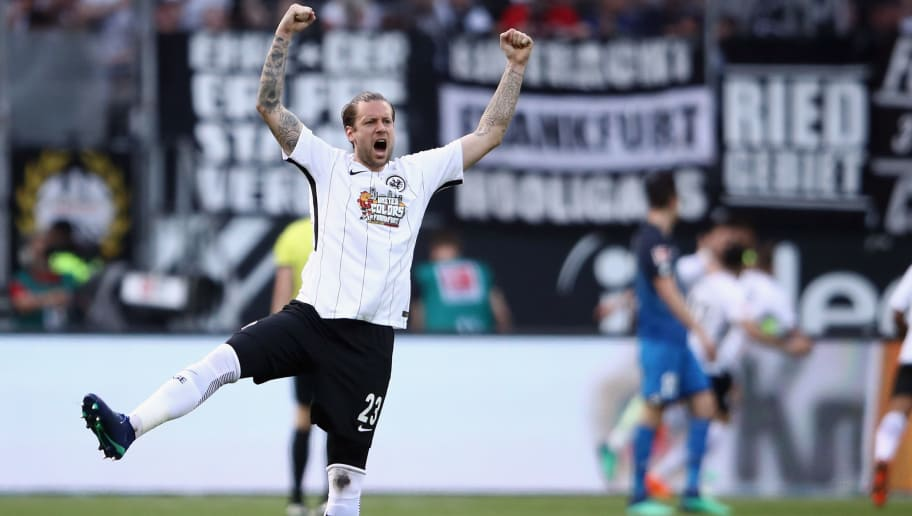 FRANKFURT AM MAIN, GERMANY - APRIL 08: Marco Russ of Frankfurt celebrates after team mate Luka Jovic scored his team's first goal during the Bundesliga match between Eintracht Frankfurt and TSG 1899 Hoffenheim at Commerzbank-Arena on April 8, 2018 in Frankfurt am Main, Germany.  (Photo by Alex Grimm/Bongarts/Getty Images)