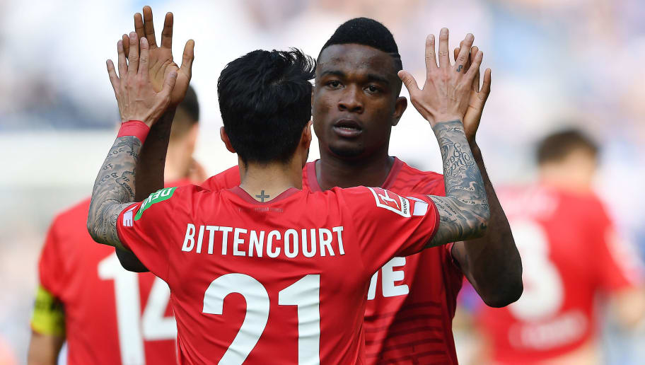 BERLIN, GERMANY - APRIL 14: Leonardo Bittencourt of Koeln (l) celebrates with Jhon Cordoba of Koeln after he scored a goal to make it 0:1 during the Bundesliga match between Hertha BSC and 1. FC Koeln at Olympiastadion on April 14, 2018 in Berlin, Germany. (Photo by Stuart Franklin/Bongarts/Getty Images)