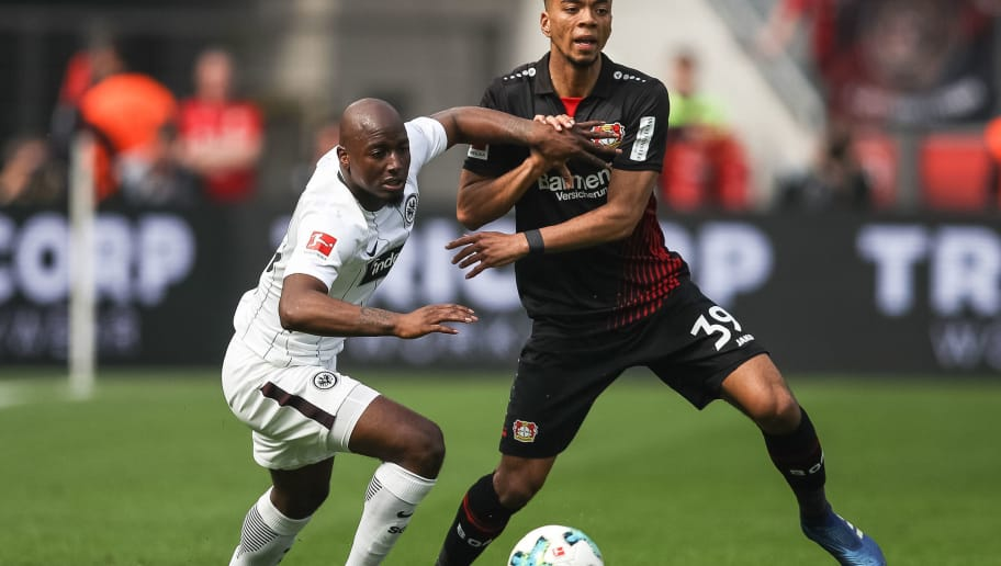 LEVERKUSEN, GERMANY - APRIL 14: Benjamin Henrichs #39 of Bayer Leverkusen battles for the ball with Jetro Willems #15 of Eintracht Frankfurt of Eintracht Frankfurt  the Bundesliga match between Bayer 04 Leverkusen and Eintracht Frankfurt at BayArena on April 14, 2018 in Leverkusen, Germany. (Photo by Maja Hitij/Bongarts/Getty Images)