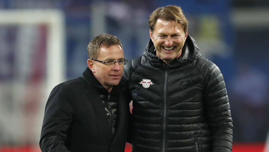 LEIPZIG, GERMANY - DECEMBER 17: Head coach Ralph Hasenhuettl of RB Leipzig and his manager Ralf Rangnick hug after winning the Bundesliga match between RB Leipzig and Hertha BSC at Red Bull Arena on December 17, 2016 in Leipzig, Germany.  (Photo by Boris Streubel/Bongarts/Getty Images)