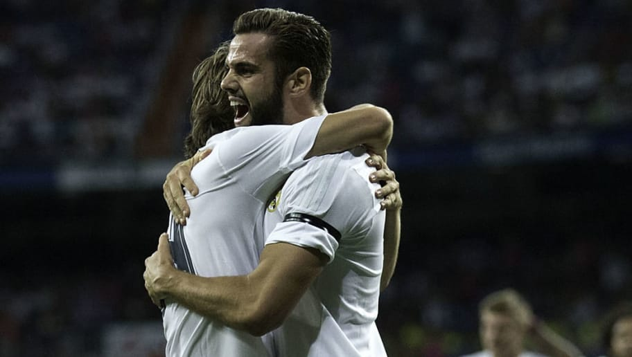 MADRID, SPAIN - AUGUST 18:  Nacho Fernandez (R) of Real Madrid CF celebrates scoring their opening goal with teammate Luka Modric (L) during the Santiago Bernabeu Trophy match between Real Madrid CF and Galatasaray  at Estadio Santiago Bernabeu on August 18, 2015 in Madrid, Spain.  (Photo by Gonzalo Arroyo Moreno/Getty Images)