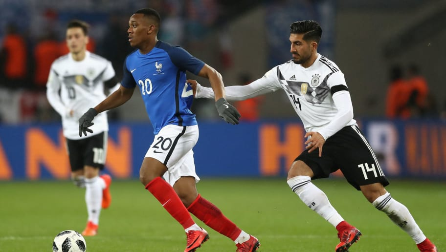 COLOGNE, GERMANY - NOVEMBER 14: Anthony Martial of France and Emre Can of Germany battle for possession during the international friendly match between Germany and France at RheinEnergieStadion on November 14, 2017 in Cologne, Germany.  (Photo by Lars Baron/Bongarts/Getty Images)