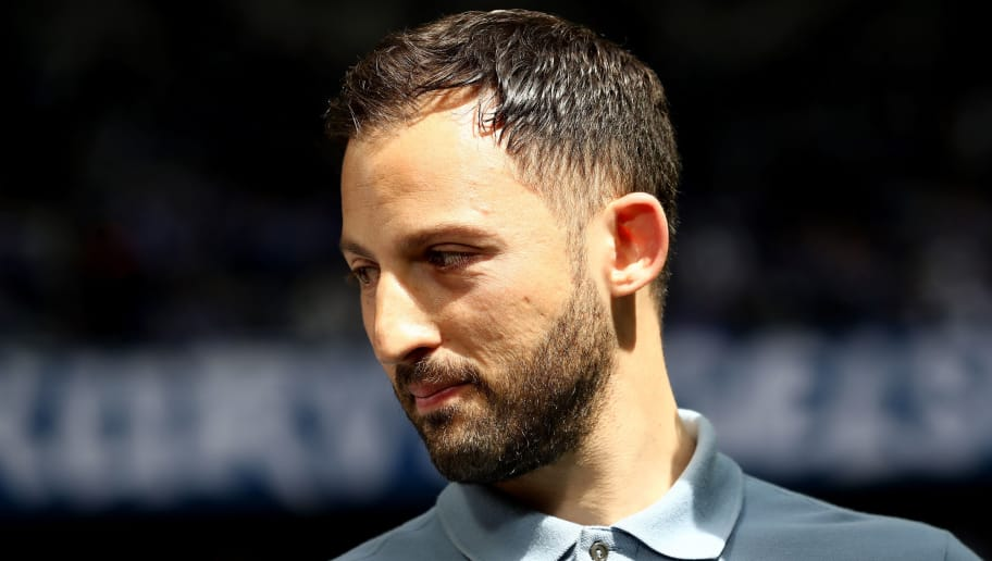 GELSENKIRCHEN, GERMANY - APRIL 15: Head coach Domenico Tedesco of Schalke looks on prior to the Bundesliga match between FC Schalke 04 and Borussia Dortmund at Veltins-Arena on April 15, 2018 in Gelsenkirchen, Germany. The match between Schalke and Dortmund ended 2-0 (Photo by Christof Koepsel/Bongarts/Getty Images)