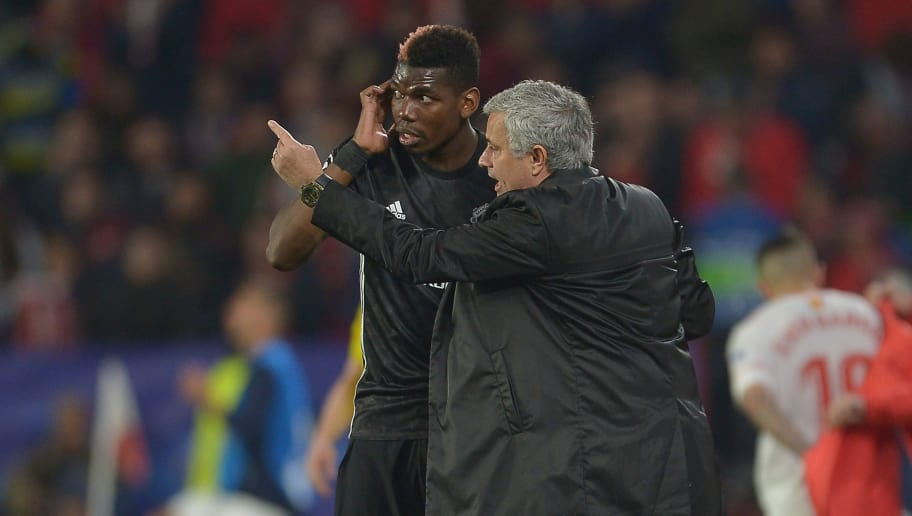SEVILLE, SPAIN - FEBRUARY 21:  Jose Mourinho, Manager of Manchester United speaks to Paul Pogba during the UEFA Champions League Round of 16 First Leg match between Sevilla FC and Manchester United at Estadio Ramon Sanchez Pizjuan on February 21, 2018 in Seville, Spain.  (Photo by Aitor Alcalde/Getty Images)