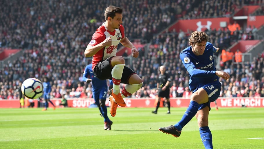 Chelsea's Spanish defender Marcos Alonso (R) plays the ball past Southampton's German-born Portuguese defender Cedric Soares (L) during the English Premier League football match between Southampton and Chelsea at St Mary's Stadium in Southampton, southern England on April 14, 2018. / AFP PHOTO / Glyn KIRK / RESTRICTED TO EDITORIAL USE. No use with unauthorized audio, video, data, fixture lists, club/league logos or 'live' services. Online in-match use limited to 75 images, no video emulation. No use in betting, games or single club/league/player publications.  /         (Photo credit should read GLYN KIRK/AFP/Getty Images)
