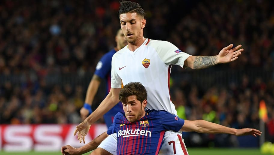 BARCELONA, SPAIN - APRIL 04: AndrŽ Gomes  of Barcelona is challenged by Lorenzo Pellegrini of Roma during the quarter final first leg UEFA Champions League match between FC Barcelona and AS Roma at Camp Nou on April 4, 2018 in Barcelona, Spain.  (Photo by Stuart Franklin/Getty Images)